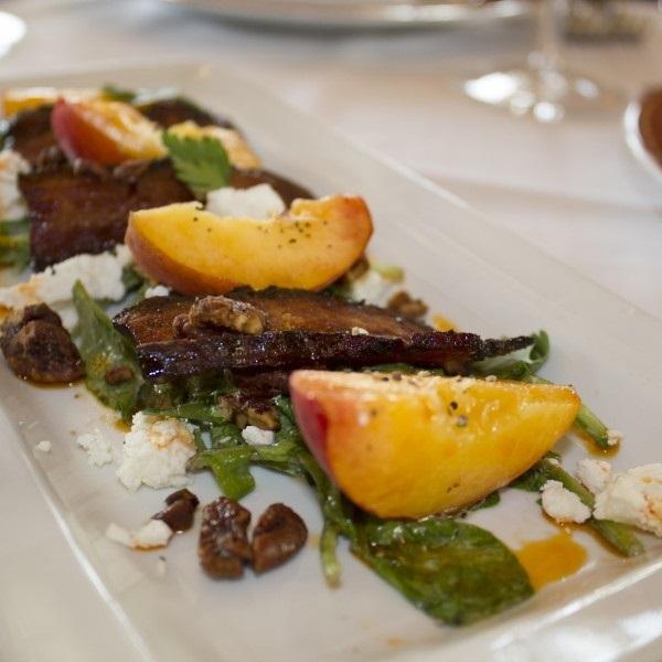 Emeril s delmonico peach salad deep south magazine for 1895 cajun cuisine menu